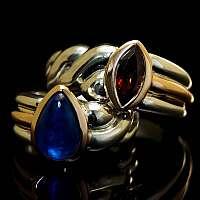 Hochzeitsringe, Eheringe 750er Rotgold und 935er Silber mit Edelsteinen