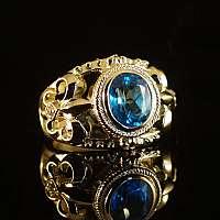 Ring aus Gold mit Topas und Diamant